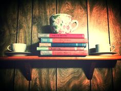 Shelf decorations!! Old books and teacups!!