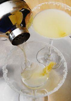 Lemon Drop Martini (2 oz vodka, 1 oz limoncello, 1/2 to 1 oz lemon or regular simple syrup, 1 oz lemon juice, sugar for rimming)