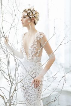 Noelle - Elegant Spring Bridal Gown with a Plunging Neckline | http://heyweddinglady.com/mira-zwillinger-wedding-dress-collection-spring-2017/