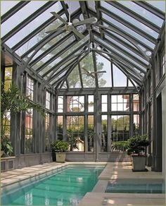 Tanglewood designed and built this elegant Steel and Glass Pool Pavilion, which   became the highlight of a large renovation project. Cast iron and aluminum details stylishly complement the work.