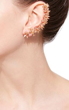 Based between Brooklyn and Beirut, jewelry designer Karma El Khalil favors a subtle elegance and plays with hidden details in her delicate, sharp pieces.This **Karma El Khalil** hedgehog ear cuff features a cluster of stars in 18k rose gold along the length of the ear.