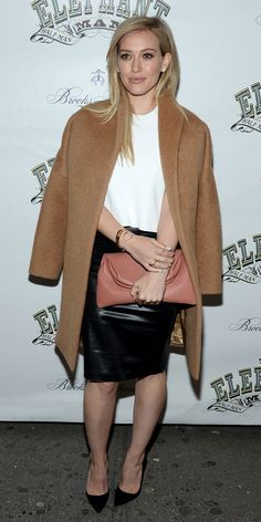 Hilary Duff looks elegant in a camel coat, leather pencil skirt and classic black pump
