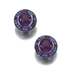PAIR OF AMETHYST AND SAPPHIRE EAR CLIPS, ELKE BERR Each centring on a cabochon amethyst within a border of circular-cut sapphires of various tints, clip fittings, signed Elke Berr, French import marks.