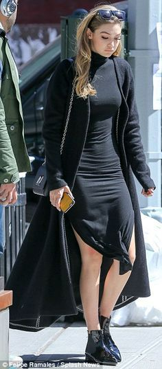 All-black: The model wore a form-fitting, turtleneck dress complete with thigh-high slits...