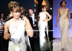 For the IIFA event being held tonight, Bipasha picked the celeb favorite, Sonaakshi Raaj draped sari-gown. An updo, Amrapali earrings and pop of color on her lips finished out the look. A definite improvement over her last sighting don't you think?