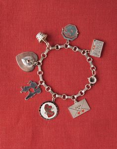 """Vintage Charms:   Collecting charms is a passion that seems never to go out of style. Marie Moss, co-owner of M & B Vintage, a source for vintage charms, tells us about these tiny gems. BURCU AVSAR.   """"Various American companies produced sterling-silver charms from the 1950s through the 1960s — among them, Wells Sterling and Beau Sterling. Charms were sold individually, but they reflected broader themes, such as states of the Union and holidays, with Valentine's Day always being one of ..."""