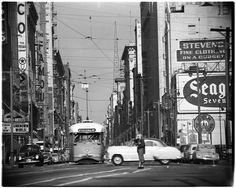 https://flic.kr/p/qe12ep | Looking north on Broadway at 9th Street, 1951 | Looking north on Broadway at 9th Street. Nice street image. Woman waiting patiently for northbound streetcar, United Artists Theater on the left showing a boffo double bill of Unknown World (a Bruce Kellogg vehicle) and Reunion in Reno with Mark Stevens, Peggy Dow and Gigi Perreau. And on the right 'Stevens. Fine Clothing on a Budget'  USC digital archive/Los Angeles Examiner Collection, 1920-1961