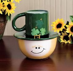 """Leprechaun Snack Set of 3 pieces  The St. Patrick's Day Leprechaun Snack Set is a fun gift and a functional serving set you can use any time of year. Add this charming leprechaun set to your St. Patrick's Day party table! Approximate size 8¼""""  x 7"""" x 7"""".  Ceramic. Food safe. Three-piece set.  Face-shaped bowl, Top of the Mornin' to You Plate and Mug with buckle and shamrocks.   A sprite of Irish folklore, Leprechauns often appear as little old men with long white beards..."""