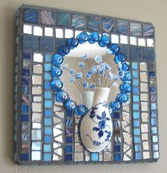 Blue Mosaic Wall Pocket, Floral Mosaic Wall Art, Mosaic Home Decor, Mosaic Mirror. $37.75, via Etsy.