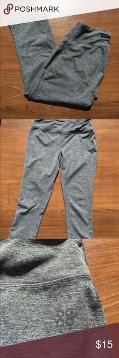 grey athletic gym yoga legging crop Capri -Used, but in great condition -excellent fit, they don't fall down as you work out, and are flattering -Zipper pocket in the back -Falls about halfway between knee and ankle (I'm 5'5) -These were purchased from lady foot locker, but the tag is scratched out, so I can't see(or remember) the brand  Nike addidas fila foot locker Pants Leggings
