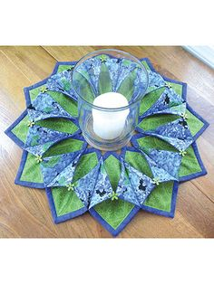 Need a pretty seasonal wreath or a unique table topper? Grab some fabric and the pre-cut stabilizer below and whip up this dimensional design in just an afternoon and you'll have a one-of-a-kind look to show off to all your friends and family! Fold and stitch wreath or table topper sewing pattern .  (aff link)