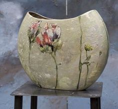 """Claire Basler, artist, France. Barbotine on Earthenware. Barbotine is a derivative of the French for """"ceramic slip."""" Barbotine can refer to both decorating techniques and to a specific type of pottery."""