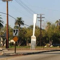 Pasadena, California: Giant Fork  An 18-foot-tall rouge utensil, stuck into the ground under cover of darkness at a fork in a road. - See more at: http://www.roadsideamerica.com/tip/23532#sthash.jZ0ZMluH.dpuf