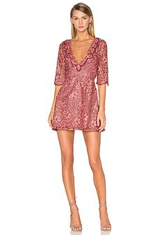 fa98026951c9 For a mini dress that's gorgeous, daring, and pink you have to go with this  floral patterned, sexy little For Love & Lemons Theodora Dress in mauve and  rose