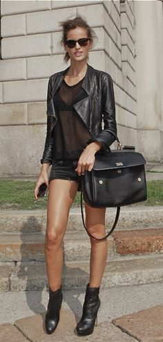 Izabel Goulart...I like the jacket the BAG the shoes...the rest of the clothes (what little is there), not so much!