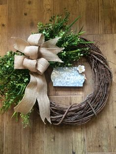 A personal favorite from my Etsy shop https://www.etsy.com/listing/470449529/18-grapevine-greenery-welcome-wreath