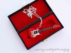 Kitsch Real Looking Guitar With Strings Necklace by CharmsByIzzy, £15.00