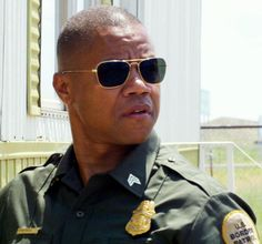 cuba gooding jr - so damn sexy in a cop uniform.
