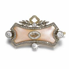 A FABERGÉ DIAMOND AND ENAMEL BROOCH, WORKMASTER ALFRED THIELEMANN, ST PETERSBURG, 1904-1908 centred with an oval-cut diamond on a convex ground of translucent pale pink enamel over sunburst engine-turning within rose- and circular-cut diamonds, the surmount of tied leaf sprays, struck with workmaster's initials, 56 standard, scratched inventory number 80020 or 89029.
