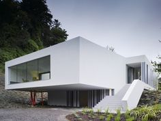 This two storey house with its simple bold structure form is from ODOS architects in Ireland. The house was built to replace the original single storey cottage that previously existed on the site