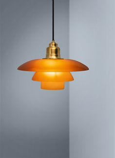 Amber coloured pendant by Louis Poulsen | April and May
