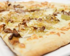 This is a delicious fall pizza that's elevated by the use of woodsy chanterelle mushrooms and nutty Gruyère cheese.