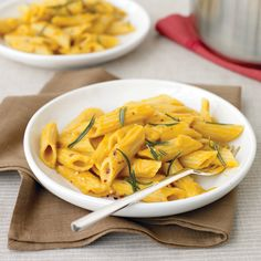 Canned pumpkin puree isn't only good for pie; here, it becomes a creamy sauce for penne, topped with deliciously crunchy fried rosemary.