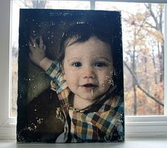 A tutorial on how to transfer your own picture onto a canvas using just a canvas, printed picture on regular paper, water, squeegee tool and gel medium.  so fun!