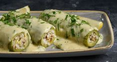 Stuffed zucchini in egg lemon sauce by Greek chef Akis Petretzikis. A delicious, traditional Greek recipe made with fresh zucchinis stuffed with ground meat! Easy Cabbage Recipes, Sauce Recipes, Cooking Recipes, Lemon Sauce, Comfort Food, Mediterranean Recipes, Food Dishes, Dishes Recipes, Greek Recipes