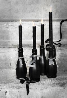 diy Wedding Crafts: Black Bottle Candle Table Numbers - http://www.diyweddingsmag.com/diy-wedding-crafts-black-bottle-candle-table-numbers/