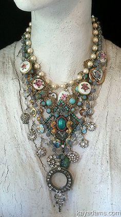 Love the combination of turquoise, rhinestone and the roses.