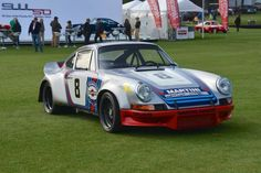 """1973 Porsche 911 RSR 2.8 R6 Most of the 1973 season R6 was raced by the Porsche factory under Martini sponsorship. Roger Penske then acquired the car for Watkins Glen and it ran the last race of the season with Sunoco sponsorship. Of the seven 300 horsepower """"R"""" cars, R6 was the one most actively raced by the factory. Competed in 10 events in 1973 and finished in the top-ten an impressive 7 times. Only RSR featuring the original rear spoiler."""