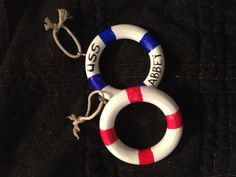 Wooden curtain rings convert into lifesaver rings for a nautical ornament.