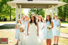 The bridesmaids walking into the meadow. Jessica + Taylor's wedding at Lenora's Legacy.