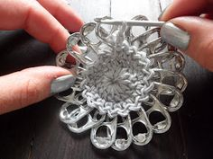 A crochet flower purse, made from little pop tabs from soda. What do you do with these little pop tabs after drinking all the soda and beer? You can make beutiful crochet pop tab projects, as … Read more. Soda Tab Crafts, Bottle Cap Crafts, Pop Tab Bracelet, Crochet Stitches, Crochet Patterns, Soda Tabs, Pop Cans, Textile Jewelry, Crochet Crafts