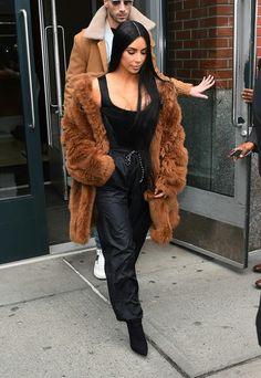 Kim Kardashian wears Vivienne Westwood top, Coach coat, Adidas pants, Yeezy boots #NYFW https://tmblr.co/ZsHPtc2Pa3h-s