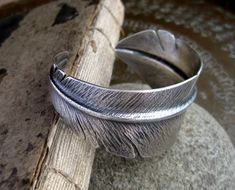 I am really drawn to the symbolism of feathers these days.  This is a really pretty bracelet.