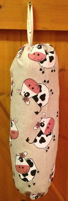 This is a fabulous new range that has been created from a bespoke customer request.  Carrier Bag holders.  Not only do they help do your bit for the environment they look great in your utility room or kitchen too.  This one is the cheeky cow fabric but can be made in any of the Crafty Ted materials.  £7