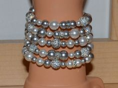 Swarovski Pearl and Pave Crystal Disco Ball Bead Memory Wire Bracelet in Shades of Ivory White and Silver Gray - 5 loops - SW8 by AshleySparkle on Etsy https://www.etsy.com/listing/106962395/swarovski-pearl-and-pave-crystal-disco