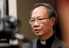 Father Jim Khoi talks to the media before evening mass at the Our Lady of Fatima Catholic Church in Fort Worth, Texas, Monday, Oct. 13, 2014. Ebola patient Nina Pham is a member of the church.