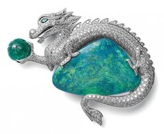 Cartier platinum brooch with one opal, one ribbed emerald, brilliants, emerald eyes #opalsaustralia