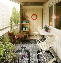 When it comes to designing your apartment balcony you should not hold back especially on the carpeting, choose a great looking carpet that mixes well with your furniture and potted plants.