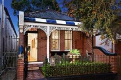 Before renovated tasty heritage House Leichhardt architecture Renovation by Rolf Ockert Design in adding visibly modern touches with brick tile facade and small front yard garden Small Porches, Brick Tiles, Building Structure, House Extensions, Fence Design, Traditional House, Urban Design, Colorful Interiors, Beautiful Homes