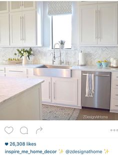 I love the cupboards. Needs to be a bit darker counters and back splash for me.