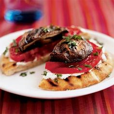Grilled portobello goat cheese pitas (works just as well without a grill: warm up your pitas in the toaster oven, grill your mushrooms in a grease-less pan, smear the pita with goat cheese, basil, tomato, grilled mushroom, salt and pepper. Done.)
