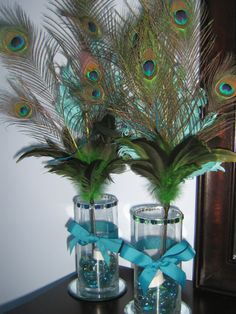 DIY Peacock Feather Centerpieces  (For a pretty glow, add battery-operated tea-lights inside vases)