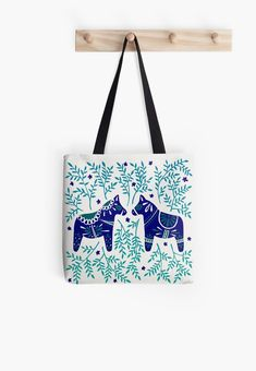 Buy 'Swedish Dala Horses – Navy & Blue Palette' by Cat Coquillette as a T-Shirt, Classic T-Shirt, Tri-blend T-Shirt, Lightweight Hoodie, Women's Fitted Scoop T-Shirt, Women's Fitted V-Neck T-Shirt, Women's Relaxed Fit T-Shirt, Graphic T-Sh...