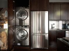 Like the cabinet colors do not like the laundry next to the fridge Concealed Laundry In the 2010 HGTV Urban Oasis Laundry In Kitchen, Laundry Center, Laundry Room Shelves, Small Laundry, Laundry Room Organization, Laundry Room Design, Laundry Rooms, Laundry Storage, Organizing