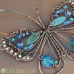 My blue adonis butterfly is a rather grand creation with wirework detailing, sea glass and gemstones.