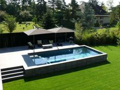 contemporary rectangular block pool by Leader Pool.